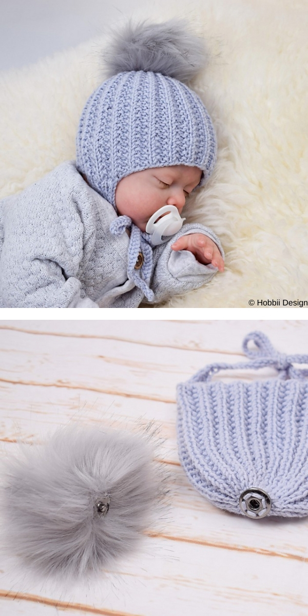 Newborn with tiny blue hat with pompon