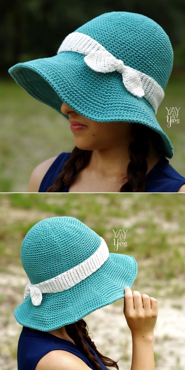 woman in teal hat